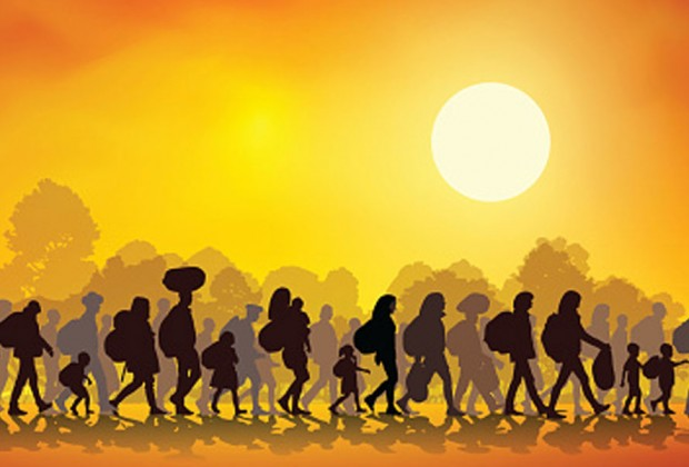Refugees walking along with their belongings. Image credit:Thinkstock