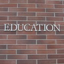Brick wall with letters spelling education written on it