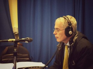 OU Vice-Chancellor Peter Horrocks wearing headphones in front of a microphone