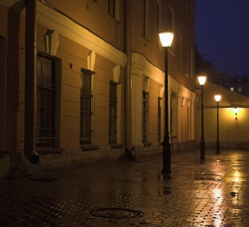 Street lamps and stone pavement at night. Image credit: Thinkstock