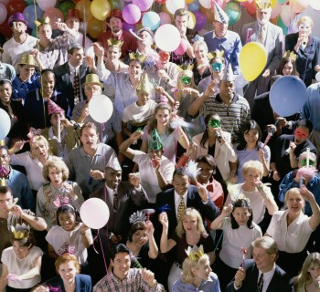 Photograph of a large group of people celebrating