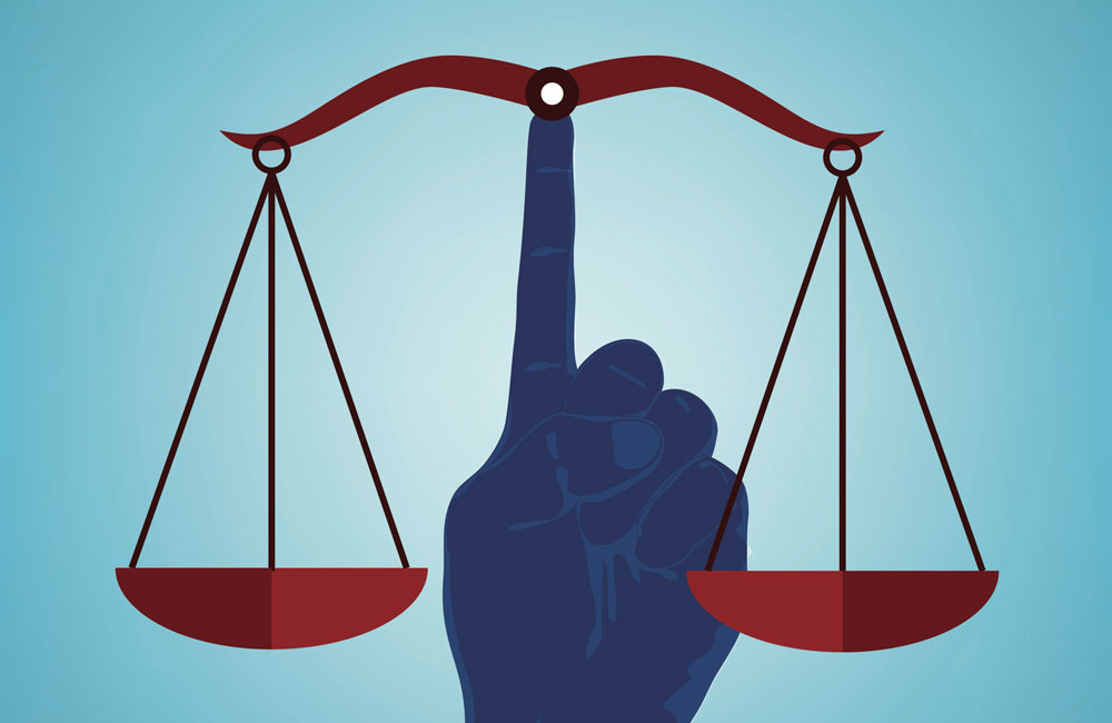 Hand holding up two scales. Image credit: Thinkstock