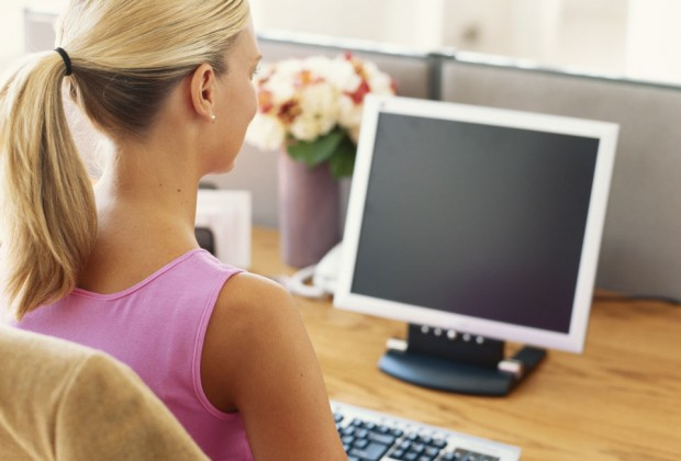 Woman sitting at a desktop computer