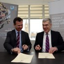 Mark Lancaster MP and Keith Zimmerman, University Secretary signing the Armed Forces Covenant.
