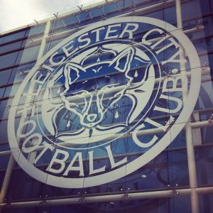 Leicester City FC emblem on front of stadium