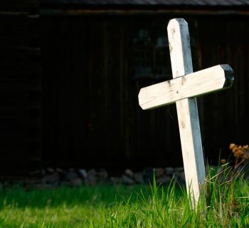 Wooden cross in a graveyard. Image credit: Thinkstock
