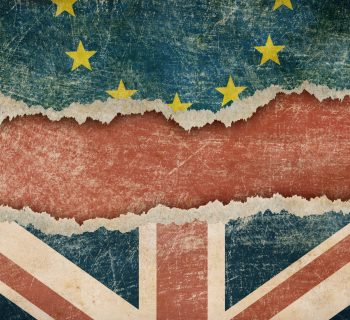 Torn European and Union Jack flags