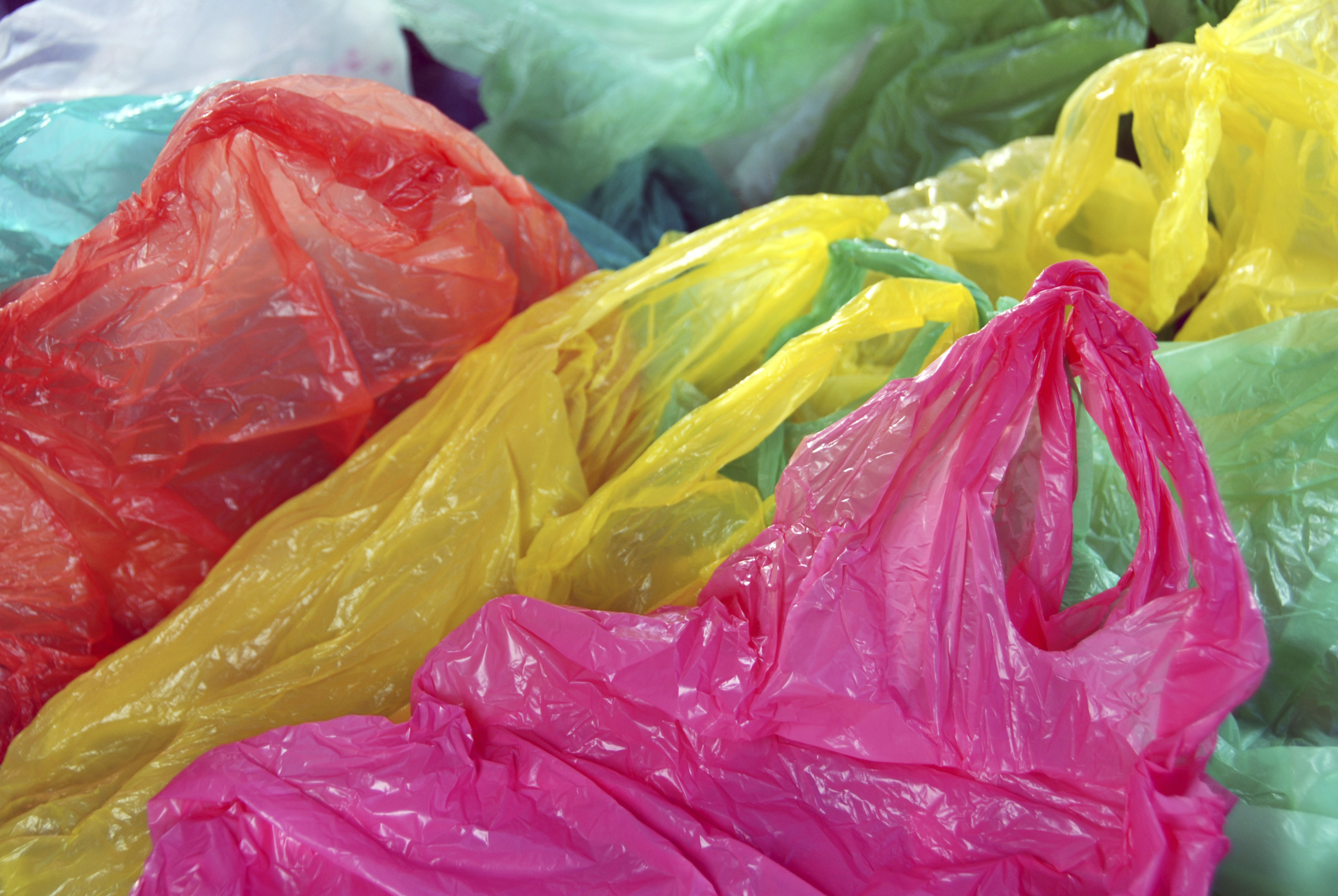 Coloured plastic carrier bags. Image credit: Thinkstock