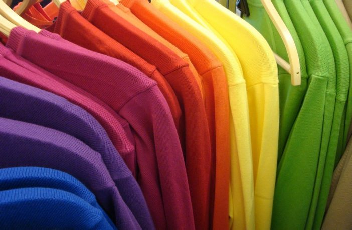 Clothes rail of coloured T-shirts