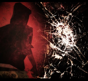 Hooded youth and smashed glass