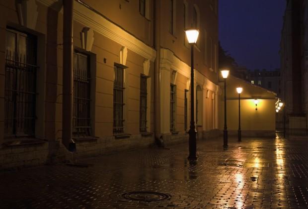 Street lamps and stone pavement at night. Image credit: Thinkstock