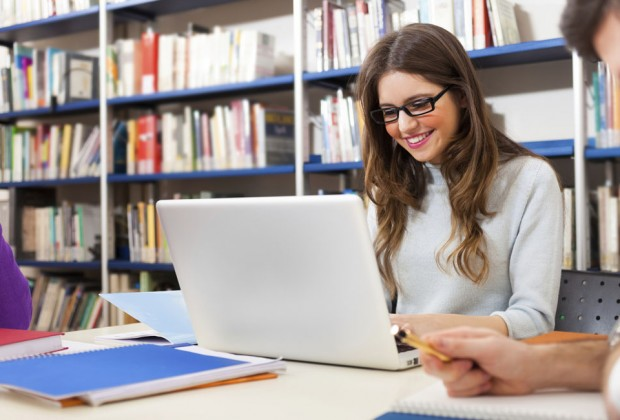 Girl doing computer research in a library. Image credit: Thinkstock