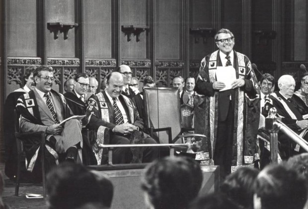 The Open University Chancellor Asa Briggs addressing the audience at a graduation ceremony.