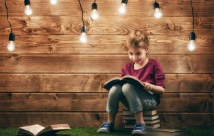 Cute little child girl reading a book. Image credit: Thinkstock