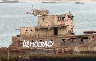Boat with DEMOCRACY graffitti