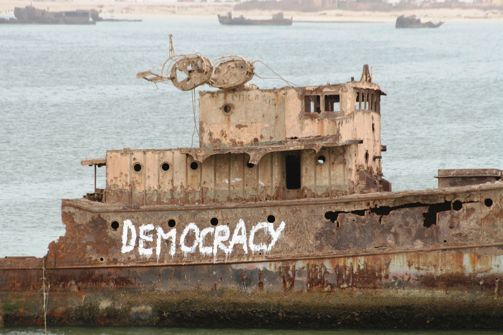 Boat with DEMOCRACY graffitti