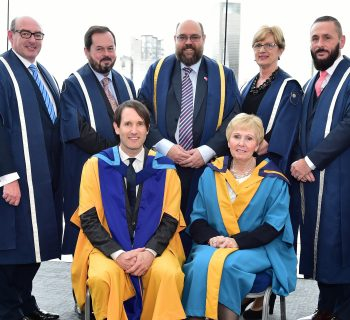 Standing L-R: John D'Arcy, Nation Director of The Open University, John Addy, Assistant Director, Professor Kevin Hetherington, Pro-Vice Chancellor, Heather Laird, Assistant Director, Simon Gregg, Student Services Manager Front Row: L-R Tim Wheeler, Doctor of the University and Catherine Bell CBE, Master of the University.