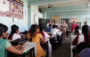 Teacher delivering material in a classroom