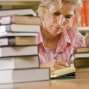 Image of Woman with books in library