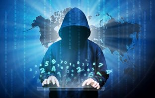 Computer hacker silhouette of hooded man with binary data and network security terms. Thinkstock