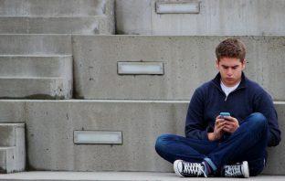 Boy looking at a phone