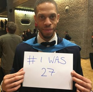 Graduate holidng up a sign saying #Iwas 27