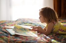 Photo of little girl reading a book