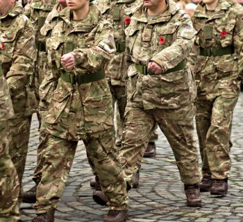 photograph of UK military personnel marching
