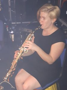 Kimberley Jesson playing saxophone