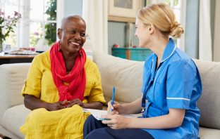 nurse in community setting with patient