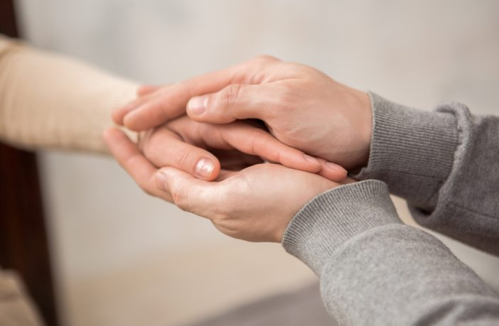 Picture of someone holding another person's hand