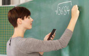 Teacher using a mobile phone