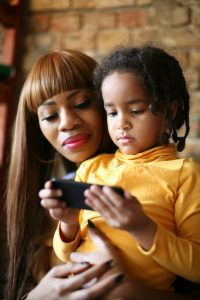 Mother and child using phone
