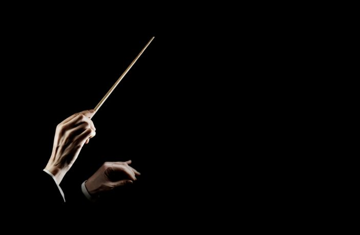 A conductor of a symphony