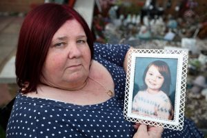 Michelle Johnson-Hadaway holds a photo of her daughter Karen