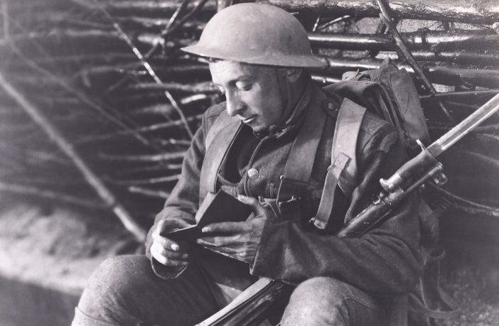 Solider reading a book