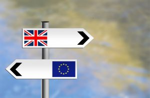 UK and Europe signposts pointing in opposite directions