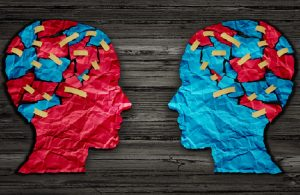 Red and blue human head cut from crumpled paper as a symbol for understanding political opinions or cultural differences