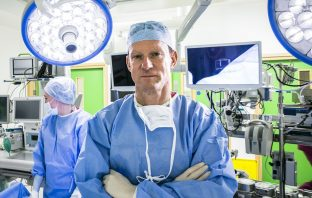 Surgeon standing in operating theatre