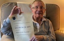 Wilfred Mansbridge holding his OU degree certificate