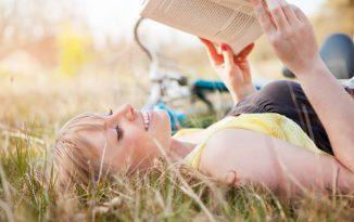 Girl reading in a field