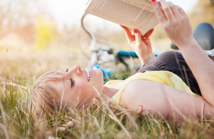 Girl reading in a field