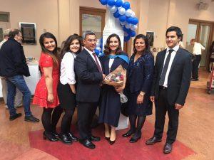 Open University graduate Shabnam Nasimi and family