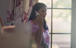 Rehana Awan, on the phone to a student