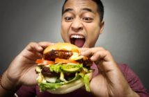 Man eating a huge burger