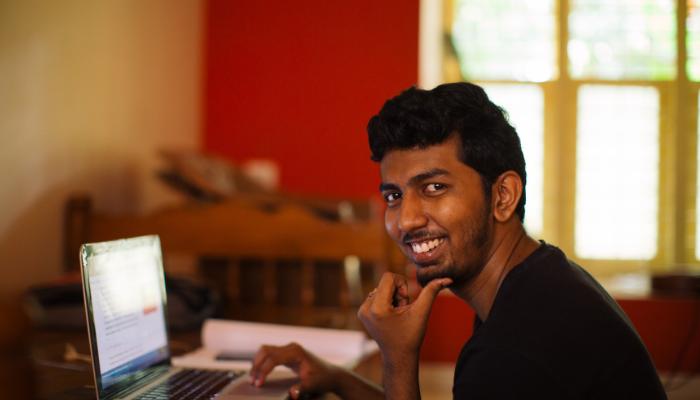Sridev studying at his computer