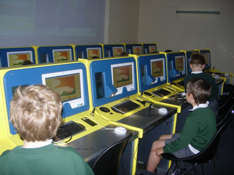 School children sat at Mission Control computer terminals
