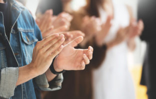 Photograph of people's hands clapping