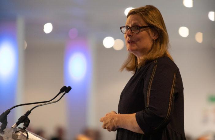 photograph of Sarah Brown at podium