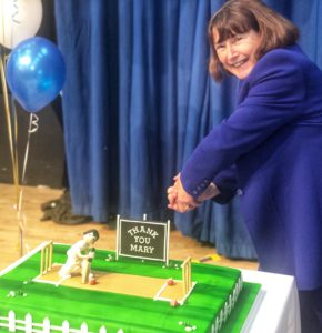 Photograph of Mary cutting cake